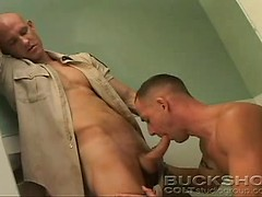 Bald police officer puts his cock in man mouth