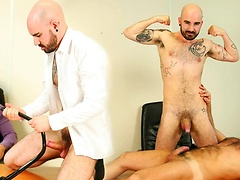 Carlo Cox plays the strict boss with Matteo Valentine