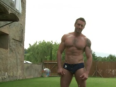 Muscular guy posing outdoors