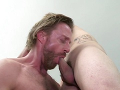Sven Norse and Charles Gray passionately make out at the foot of the bed