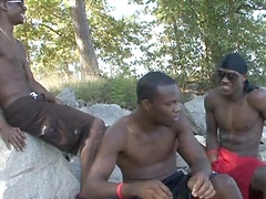 This threesome of black hotties get all sorts of frisky in the outdoors for this video. Stripping off and showing off...