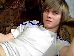 Skinny blond twink Raos takes to the couch and gets his cock out to stroke it eagerly. The green-eyed beauty looks so...