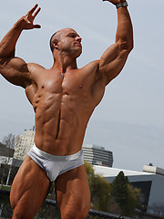 Kyle shows his hot muscled body - Gay porn pics at GayStick.com