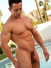 Real muscled guy posing near the pool - Gay porn pics at GayStick.com