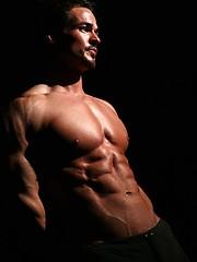 Muscular guy Chris Adams posing - Gay porn pics at GayStick.com