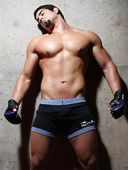 Muscled latino boxer shows his naked body
