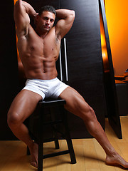 Muscled hunk posing at camera