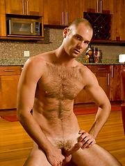 Hairy bear rides hard love-tool - Gay porn pics at GayStick.com