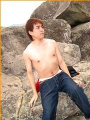 Cute Japanese guy gets naked on the beach - Gay porn pics at GayStick.com
