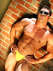 Bodybuilder Mike Morelli poses in and out of his jockstrap - Gay porn pics at GayStick.com
