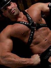 Massive muscle stud Rocky in a hot leather set. - Gay porn pics at GayStick.com