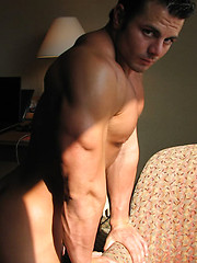Frank Defeo gets naked and poses on a bed - Gay porn pics at GayStick.com
