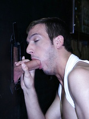 Blow Job Through the Glory Hole - Gay porn pics at GayStick.com