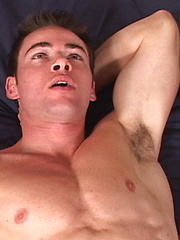Hot athlete grabs his dick - Gay porn pics at GayStick.com