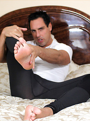 Marcello is wearing a horny wetsuit and playing with his dick - Gay porn pics at GayStick.com