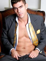 Hunk takes off his suite - Gay porn pics at GayStick.com