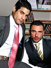 Muscled buddies in suits play in office