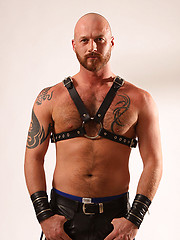 Alan Knight in leather shows cock