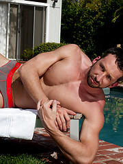 Hot hunk posing by the pool
