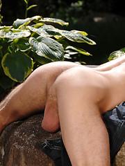 Nice looking stud outdoors - Gay porn pics at GayStick.com