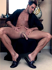 Brunette guy Marcello slides his cock between shoes