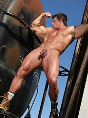 Muscle gay star Zeb Atlas posing for Manifest Gold site