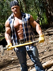 Hot hunk demonstrates hisd muscles in a forest - Gay porn pics at GayStick.com