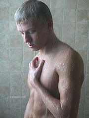 Pretty blonde college jock stroking his huge dick - Gay porn pics at GayStick.com