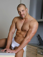 Bald bodybuilder Dario Levi strips naked - Gay porn pics at GayStick.com