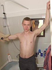 Tattooed twink rubs his muscled ass in the shower - Gay porn pics at GayStick.com