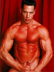 Sexy bodybuilder shows off his hardon - Gay porn pics at GayStick.com