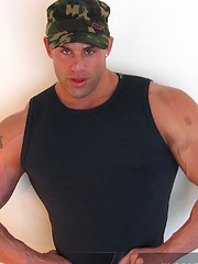 Muscled Peter Latz strips out of his fatigues - Gay porn pics at GayStick.com