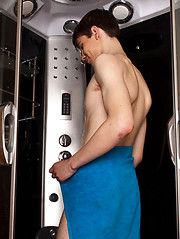 Bold twink enjoys a nice tug job in a shower cabin - Gay porn pics at GayStick.com
