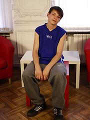 Sporty teen boy getting rid of his baggy clothes - Gay porn pics at GayStick.com