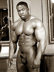 Naked black bodybuilder Chuck Basher showing his muscled body - Gay porn pics at GayStick.com