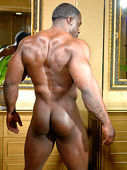Naked black bodybuilder Chuck Basher showing his muscled body