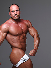 Fantasy bald muscle daddy Hans Hoffmann - Gay porn pics at GayStick.com