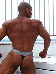 Bald muscle dude Lucius demonstrates his bubble butt - Gay porn pics at GayStick.com