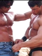 Two strong bodybuilders relaxin in the desert