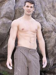 Straight guy posing before camera - Gay porn pics at GayStick.com