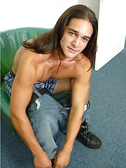 Long-haired stud Andy undress his pants - Gay porn pics at GayStick.com