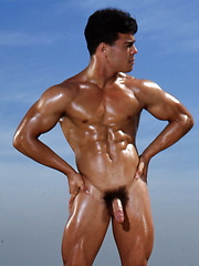 Hot muscle stud shows his ripped body and big cock - Gay porn pics at GayStick.com