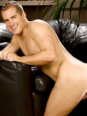Fresh stud lying on the black leather sofa and showing his cock - Gay porn pics at GayStick.com
