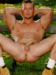 Garden worker relaxing at grass