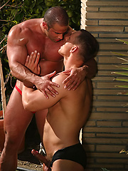 Muscular bodybuilders playing at the pool - Gay porn pics at GayStick.com