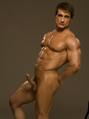 Straight bodybuilder undress his clothes and posing before camera - Gay porn pics at GayStick.com