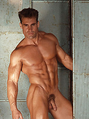 Muscled man posing in the retro style shoots - Gay porn pics at GayStick.com