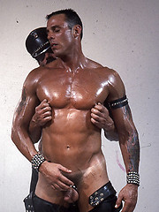 Hot muscled hunks in leather clothes in one hardcore scene - Gay porn pics at GayStick.com