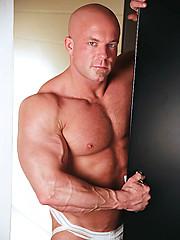 Bald muscle man posing - Gay porn pics at GayStick.com