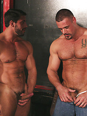 Beefy hunks playin at the pool table